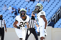 CHAPEL HILL, NC - NOVEMBER 14: Christian Beal-Smith #26 and Jaquarii Roberson #5 of Wake Forest celebrate a touchdown during a game between Wake Forest and North Carolina at Kenan Memorial Stadium on November 14, 2020 in Chapel Hill, North Carolina.