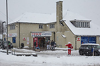 A father Christmas waves to people as they enter Tesco<br /> Weather - the Snowfall in High Wycombe, England on 10 December 2017. Photo by Andy Rowland.