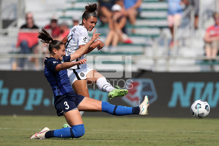 CARY, NC - SEPTEMBER 12: Sophia Smith #9 of the Portland Thorns FC takes a shot past Kaleigh Kurtz #3 of the North Carolina Courage during a game between Portland Thorns FC and North Carolina Courage at Sahlen's Stadium at WakeMed Soccer Park on September 12, 2021 in Cary, North Carolina.