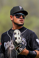 Lansing Lugnuts outfielder Norberto Obeso (9) heads into the dugout between innings during a Midwest League game against the Wisconsin Timber Rattlers on May 8, 2018 at Fox Cities Stadium in Appleton, Wisconsin. Lansing defeated Wisconsin 11-4. (Brad Krause/Four Seam Images)