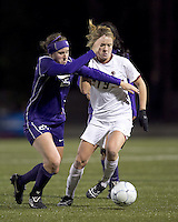 """Boston College forward Kristen Mewis (19) dribbles as University of Washington defender Molly Boyd (25) pressures. In overtime, Boston College defeated University of Washington, 1-0, in NCAA tournament """"Elite 8"""" match at Newton Soccer Field, Newton, MA, on November 27, 2010."""
