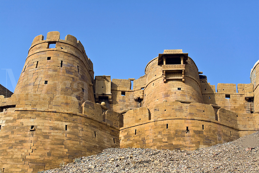 Two of the ninety nine BASTIONS which make of the outer wall of JAISALMER FORT built in 1156 on Trikuta Hill out of sandstone - RAJASTHAN, INDIA.