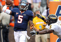 Virginia Cavaliers quarterback David Watford (5) throws the ball away under pressure from Southern Miss Golden Eagles defensive back Cameron O'Neal (3) during the game at Scott Stadium. Virginia lost to Southern Mississippi 30-24. (Photo/Andrew Shurtleff)