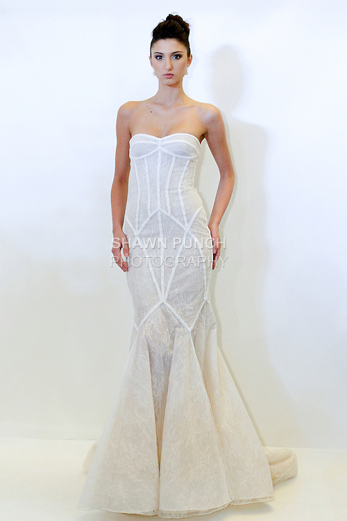 Model poses in a Lindsay bridal gown from the Rafael Cennamo Spring 2014 White Collection, during New York International Bridal Week, April 20, 2013.