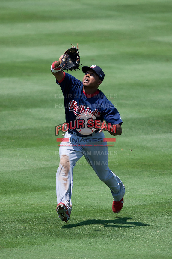 Memphis Redbirds outfielder Adron Chambers #4 tracks a fly ball during the Pacific Coast League baseball game against the Round Rock Express on May 6, 2012 at The Dell Diamond in Round Rock, Texas. The Express defeated the Redbirds 5-1. (Andrew Woolley/Four Seam Images)
