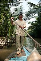 Mekong River small boat operator