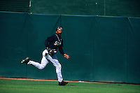 OAKLAND, CA - Ken Griffey Jr. of the Seattle Mariners chases a fly ball in center field during a game against the Oakland Athletics at the Oakland Coliseum in Oakland, California in 1999. Photo by Brad Mangin