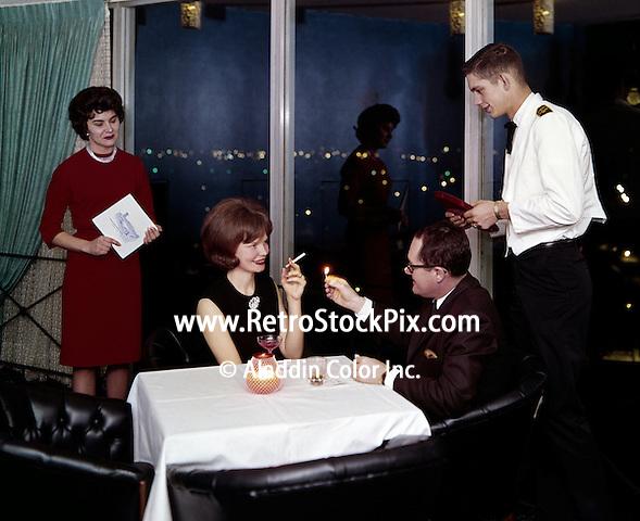 Man lighting woman's cigarette in the restaurant.