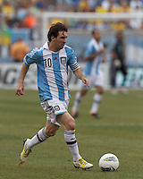 Argentina forward  Lionel Messi (10) drives for the net and scores third of his three goal effort. In an international friendly (Clash of Titans), Argentina defeated Brazil, 4-3, at MetLife Stadium on June 9, 2012.