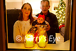 The Jones family at home in Tonavane participating in the national Shine Your Light on the eve of the 2020 winter solstice. L to r: John Paul and Sarah Jones and baby Zara Reidy.