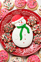 Snowman cookie on red plate