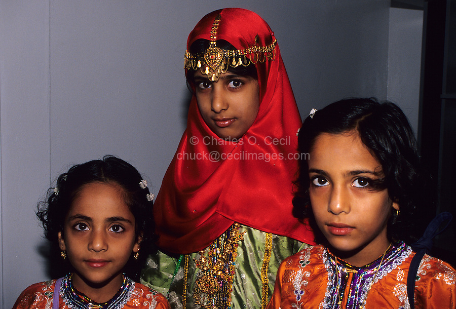 Mudayrib, Oman, Arabian Peninsula, Middle East - Omani girls wear their new clothes and jewelry to celebrate the Eid al-Adha (Feast of the Sacrifice), the annual feast through which Muslims commemorate God's mercy in allowing Abraham to sacrifice a ram instead of his son, to prove his faith.