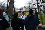 Teenage school kids on tour near the White House get informed by guide in Uncle Sam hat and vest, morning in March, Washington DC, USA, (not released) editorial only.