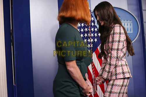 Olivia Rodrigo, left, walks out of the microphone next to Jen Psaki, White House press secretary, during a news conference in the James S. Brady Press Briefing Room with Jen Psaki, White House press secretary, at the White House in Washington, D.C., U.S., on Wednesday, July 14, 2021. <br /> CAP/MPI/RS<br /> ©RS/MPI/Capital Pictures