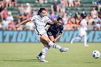 CARY, NC - SEPTEMBER 12: Rocky Rodriguez #11 of the Portland Thorns passes the ball away from Debinha #10 of the NC Courage during a game between Portland Thorns FC and North Carolina Courage at WakeMed Soccer Park on September 12, 2021 in Cary, North Carolina.
