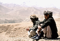 Two Hazara Mujahedin's watching the Two Hazara Mujahedin's watching the valley from the top cliff of the great giant Buddha of Bamiyan. Hazarajat, Afghanistan.