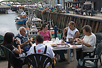 Whitstable Oyster Festival, Kent England 2007. The West family having breakfast. Have been oyster fishermen here since 1906 ( 3 generations. )