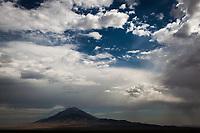 Pilot Peak rises over the surrounding landscape on a desert summer morning west of Wendover, straddling the Nevada-Utah border, USA.