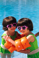 Twin girls in swimming pool.