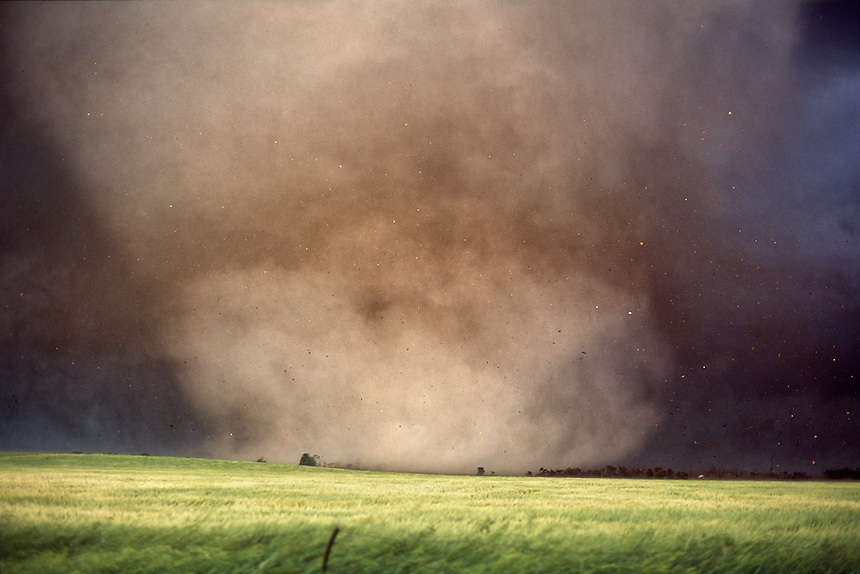 Debris flies as a large tornado destroys Manchester South Dakota on June 24th, 2003. The town was never rebuilt. This storm was part of the largest single-day outbreak of tornadoes in South Dakota history.
