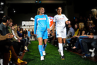 Chicago Red Stars players Nikki Krzysik and Carli Lloyd walk down the runway during the unveiling of the Women's Professional Soccer uniforms at the Event Place in Manhattan, NY, on February 24, 2009. Photo by Howard C. Smith/isiphotos.com