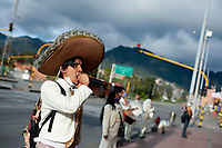Musicians Dressed as Mariachis Perform on the Streets of Bogota