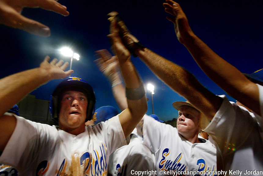 Embry-Riddle baseball players congratulate their reammate Woody Lewis, (4), as he scores one of the seven runs the team scored in the late innings of their game to clinch a NAIA World Series birth against North Georgia College and State University Friday night, May 21, 2004 in Daytona Beach.(kelly Jordan)
