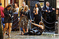 Pictured: A woman is helped to her feet in Wind Street, Swansea, south Wales, UK. Friday 21 December 2018<br /> Re: Black Eye Friday, also known as Mad Friday or Black Friday which is the last Friday before Christmas Day.
