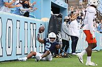 CHAPEL HILL, NC - OCTOBER 10: Dyami Brown #2 of North Carolina reacts after scoring a touchdown during a game between Virginia Tech and North Carolina at Kenan Memorial Stadium on October 10, 2020 in Chapel Hill, North Carolina.