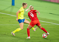 YOKOHAMA, JAPAN - AUGUST 6: Magdalena Eriksson #6 of Sweden defends Adriana Leon #9 of Canada during a game between Canada and Sweden at International Stadium Yokohama on August 6, 2021 in Yokohama, Japan.