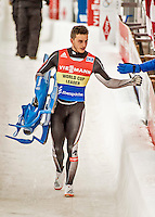 4 December 2015: Sascha Benecken, sliding for Germany with Toni Eggert, carries their sled after their second run, finishing 1st for the day with a combined time of 1:27.583 in the Doubles Competition of the Viessmann Luge World Cup at the Olympic Sports Track in Lake Placid, New York, USA. Mandatory Credit: Ed Wolfstein Photo *** RAW (NEF) Image File Available ***