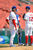 Buffalo Bisons pitching coach Bob Stanley #46 talks with pitcher Dave Bush #12 as catcher Mike Nickeas #11 listens in during the first game of a doubleheader against the Pawtucket Red Sox on April 25, 2013 at Coca-Cola Field in Buffalo, New York.  Pawtucket defeated Buffalo 8-3.  (Mike Janes/Four Seam Images)