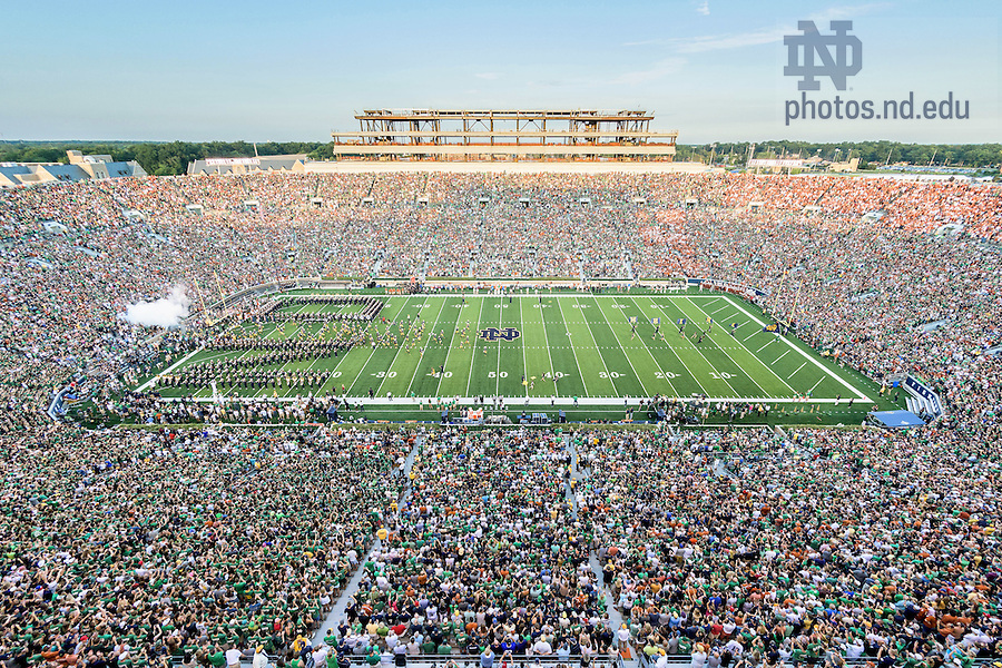 Sept. 5, 2015; The football team takes the field. Notre Dame defeated Texas 38-3. (Photo by Matt Cashore)
