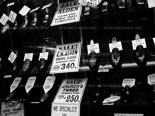 Manhattan, New York.<br /> USA<br /> Oct 2008<br /> <br /> Shoe on sale in a window display in Manhattan, New York.