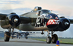 """A flight of 20, B-25 medium bombers take off from Grimes Field in Urbana, Ohio on April 17, 2012. The destination was Wright Field, hom of the National Museum of the United States Air Force. The 20 aircraft is the largest single gathering of """"Mitchell"""" bombers since World War II."""