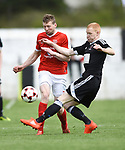 Colin Smyth of Newmarket Celtic in action against Adrian Power of Janesboro during their Munster Junior Cup semi-final at Limerick. Photograph by John Kelly.