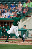Fort Wayne TinCaps left fielder Tre Carter (20) follows through on a swing during a game against the West Michigan Whitecaps on May 17, 2018 at Parkview Field in Fort Wayne, Indiana.  Fort Wayne defeated West Michigan 7-3.  (Mike Janes/Four Seam Images)