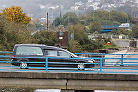 "Pictured: The hearse drives towards Margam Crematorium, Wales, UK. Monday 08 October 218<br /> Re: A grieving father will mourners on horseback at the funeral of his ""wonderful"" son who killed himself after being bullied at school.<br /> Talented young horse rider Bradley John, 14, was found hanged in the school toilets by his younger sister Danielle.<br /> Their father, farmer Byron John, 53, asked the local riding community to wear their smart hunting gear at Bradley's funeral.<br /> Police are investigating Bradley's death at the 500-pupils St John Lloyd Roman Catholic school in Llanelli, South Wales.<br /> Bradley's family claim he had been bullied for two years after being diagnosed with Attention Deficit Hyperactivity Disorder.<br /> He went missing during lessons and was found in the toilet cubicle by his sister Danielle, 12."