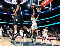 WASHINGTON, DC - JANUARY 28: Khalif Battle #4 of Butler turns to watch a shot by Jagan Mosely #4 of Georgetown during a game between Butler and Georgetown at Capital One Arena on January 28, 2020 in Washington, DC.