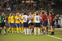 PLayers having a water break during a stoppage in play...USWNT tied Sweden 1-1 at Morrison Stadium, Omaha Nebraska.