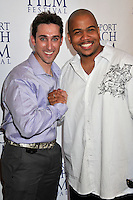 """PAUL J. ALESSI, producer/actor & OMAR GOODING.""""Knuckle Draggers"""" Premiere at the 2009 Newport Beach Film Festival held at Edwards Cinemas, Newport Beach, CA, USA..April 27th, 2009.half length red dress white shirt purple shaking holding hands .CAP/ADM/BP.©Byron Purvis/AdMedia/Capital Pictures."""