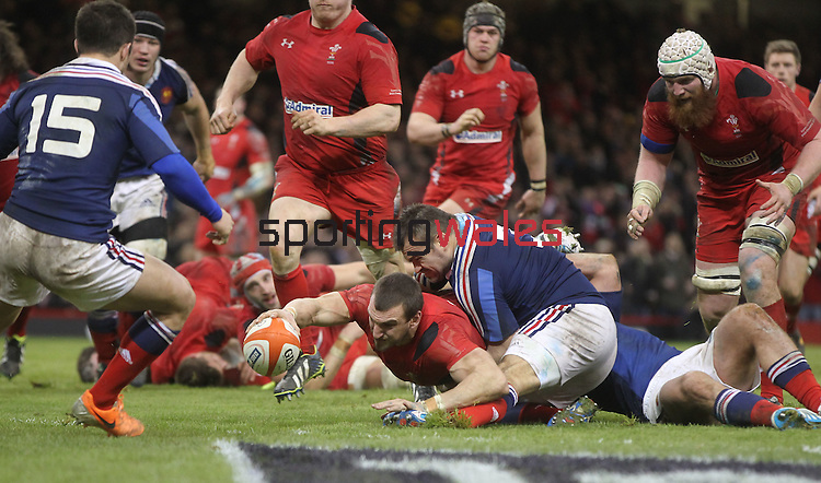 Wales captain Sam Warburton dives over to score despite the efforts of French prop Nicolas Mas to stop him.<br /> RBS 6 Nations 2014<br /> Wales v France<br /> Millennium Stadium<br /> 21.02.14<br /> <br /> ©Steve Pope-SPORTINGWALES