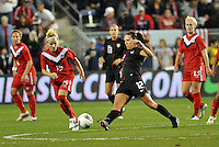 USWNT  midfielder Lauren Cheney (12) stretches for a ball.....USWNT played to a 1-1 tie with Canada at LIVESTRONG Sporting Park, Kansas City, Kansas.