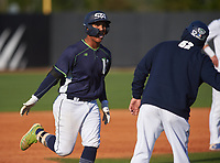 Victory Charter School Knights Jesus Santana (22) rounds the bases after hitting a home run during a game against the IMG Academy Ascenders on February 28, 2020 at IMG Academy in Bradenton, Florida.  (Mike Janes/Four Seam Images)