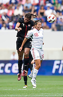 Shannon Boxx (7) of the USWNT goes up for a header with Veronica Perez (18) of Mexico during the game at Red Bull Arena in Harrison, NJ.  The USWNT defeated Mexico, 1-0.