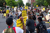 Demonstrators kneel during their march from Lafayette Square to Interstate 395 in Washington, D.C., U.S., on June 15, 2020, as they mark two weeks from the day that police cleared protesters from the area just prior to United States President Donald J. Trump's photo-op at St. John's Church.  Credit: Stefani Reynolds / CNP/AdMedia/AdMedia