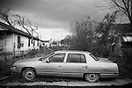 Due to the overwhelming lack of services provided to those residents, almost all African American,  of the hard hit Lower 9th Ward of New Orleans, cars, abandoned homes and trash still fill the neighborhood 6 months after Hurricane Katrina.
