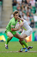 Jesse Parahi of Australia escapes the clutches of Mat Turner of England during the iRB Marriott London Sevens at Twickenham on Sunday 13th May 2012 (Photo by Rob Munro)