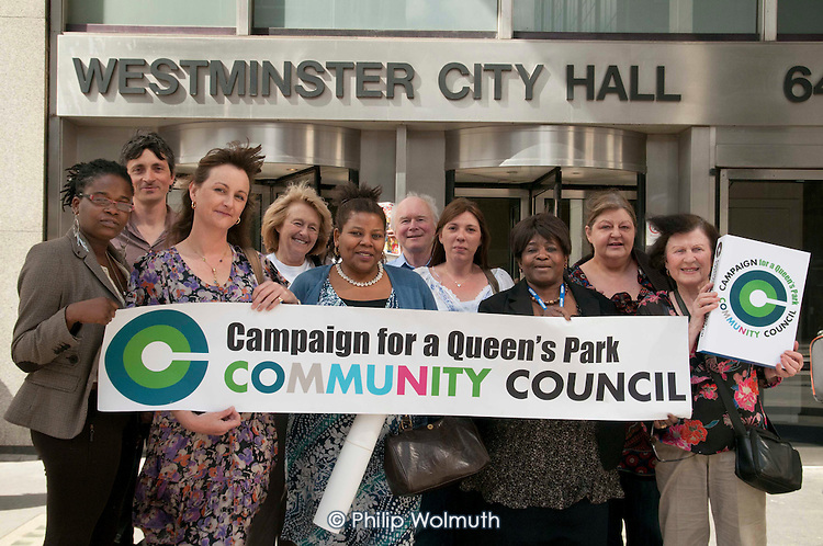 Residents from the Campaign for a Queen's Park Community Council prepare to hand over a petition to the Leader of Westminster City Council Colin Barrow and Chief Executive Mike More.