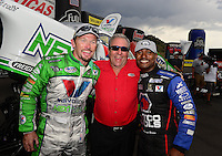 Jul, 22, 2012; Morrison, CO, USA: NHRA top fuel dragster driver Antron Brown (right) celebrates with funny car winner Jack Beckman (left) and team owner Don Schumacher after winning the Mile High Nationals at Bandimere Speedway. Mandatory Credit: Mark J. Rebilas-US PRESSWIRE